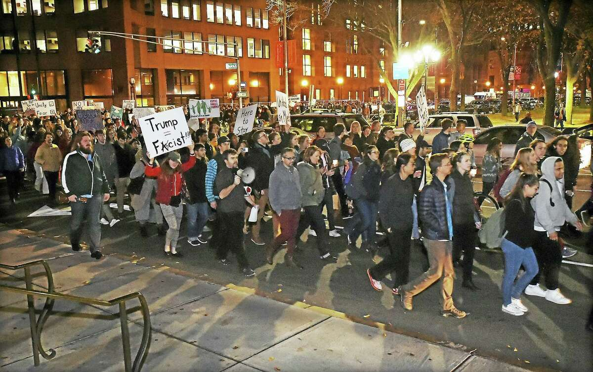 Hundreds of demononstrators march up Elm Street in New Haven Thursday protesting the victory of Donald Trump in the presidential election.