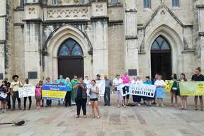 Community organizations hold a vigil at the San Fernando Cathedral Sunday evening, July 23, 2017, to honor the nine undocumented immigrants who died in a tractor-trailer parked at a San Antonio Walmart.