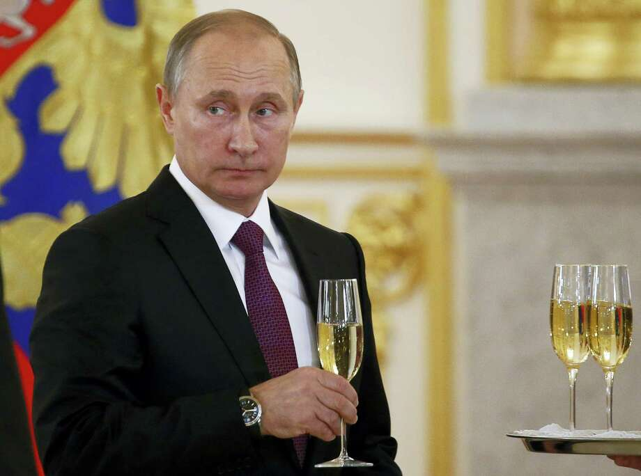 In this photo, Russian President Vladimir Putin makes a toast during a ceremony for receiving diplomatic credentials from foreign ambassadors in the Kremlin in Moscow, Russia. Photo: Sergei Karpukhin — Pool Photo Via AP   / POOL REUTERS