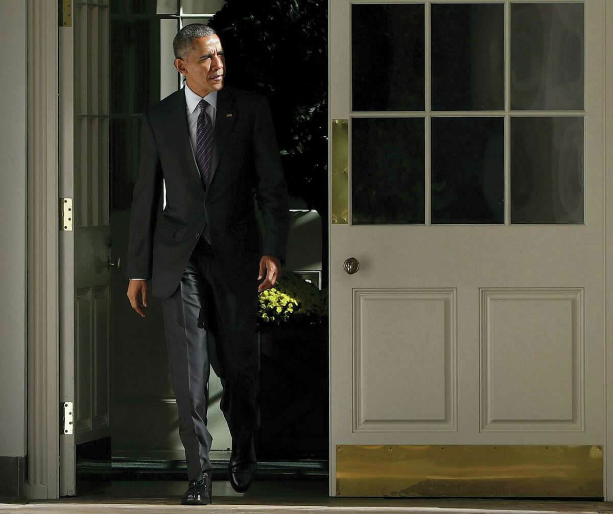 President Barack Obama walks out of the main residence of the White House and down the Colonnade and heads towards the Oval Office onTuesday, Nov. 8, 2016 in Washington.
