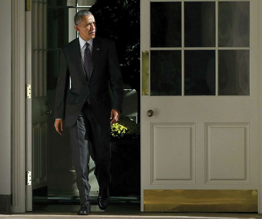 President Barack Obama walks out of the main residence of the White House and down the Colonnade and heads towards the Oval Office onTuesday, Nov. 8, 2016 in Washington. Photo: AP Photo/Pablo Martinez Monsivais   / Copyright 2016 The Associated Press. All rights reserved.