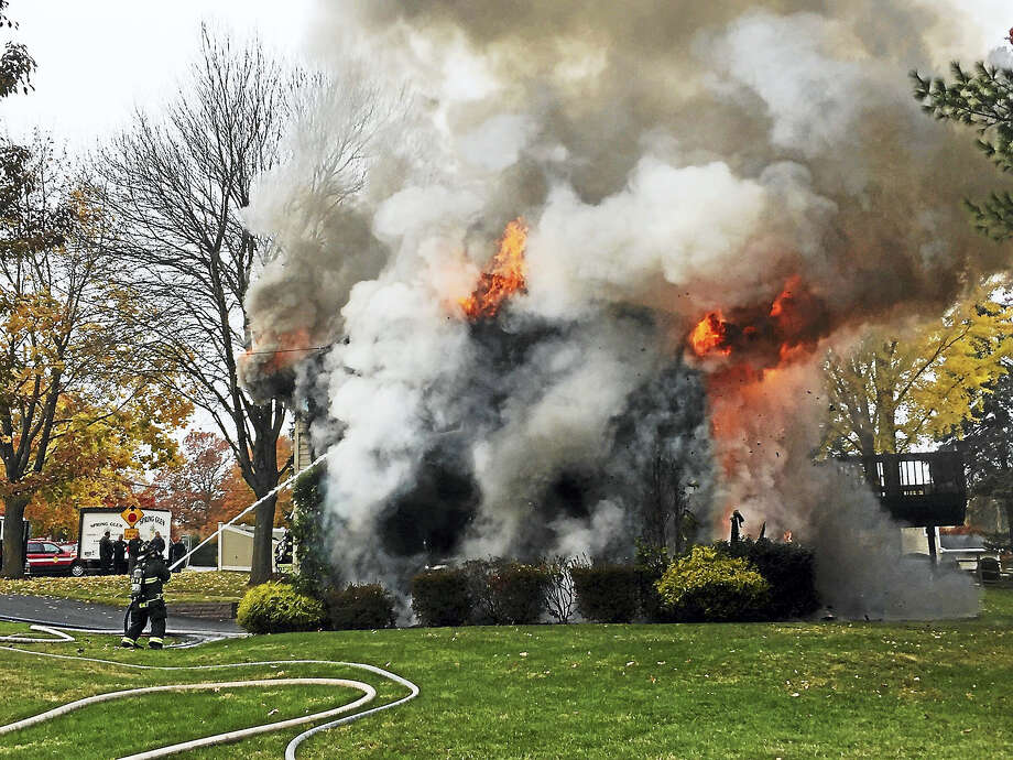 Hamden firefighters battled a blaze late Wednesday morning at 737 Choate Ave. Photo: Photo Courtesy Of William Gould