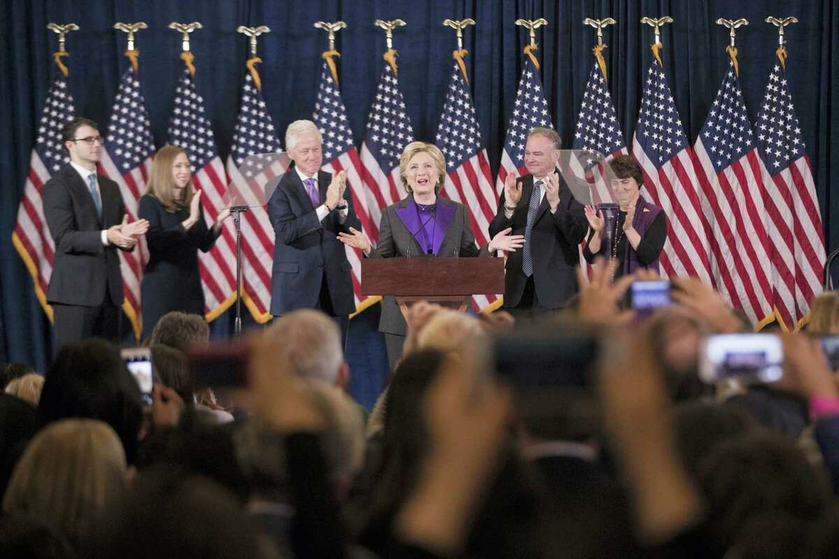 AP Photo/Matt Rourke Democratic presidential candidate Hillary Clinton, accompanied by, from left, son-in-law Marc Mezvinsky, daughter Chelsea Clinton, husband, former President Bill Clinton, vice presidential candidate, Sen. Tim Kaine, D-Va., and his wife Anne Holton, speaks in New York, Wednesday, Nov. 9, 2016. Clinton conceded the presidency to Donald Trump in a phone call early Wednesday morning, a stunning end to a campaign that appeared poised right up until Election Day to make her the first woman elected U.S. president.