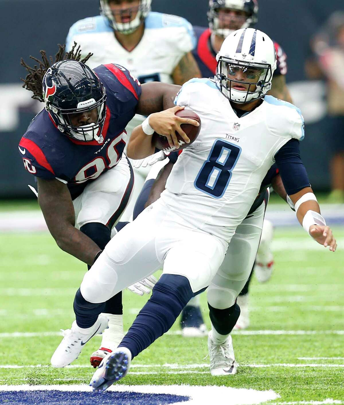 PHOTOS: McClain preview Texans-Titans Texans defensive end Jadeveon Clowney pursues Titans quarterback Marcus Mariota during a 2016 game at NRG Stadium. Browse through the photos to see a preview of the Texans' Sunday afternoon game against divisional rival Tennessee Titans.