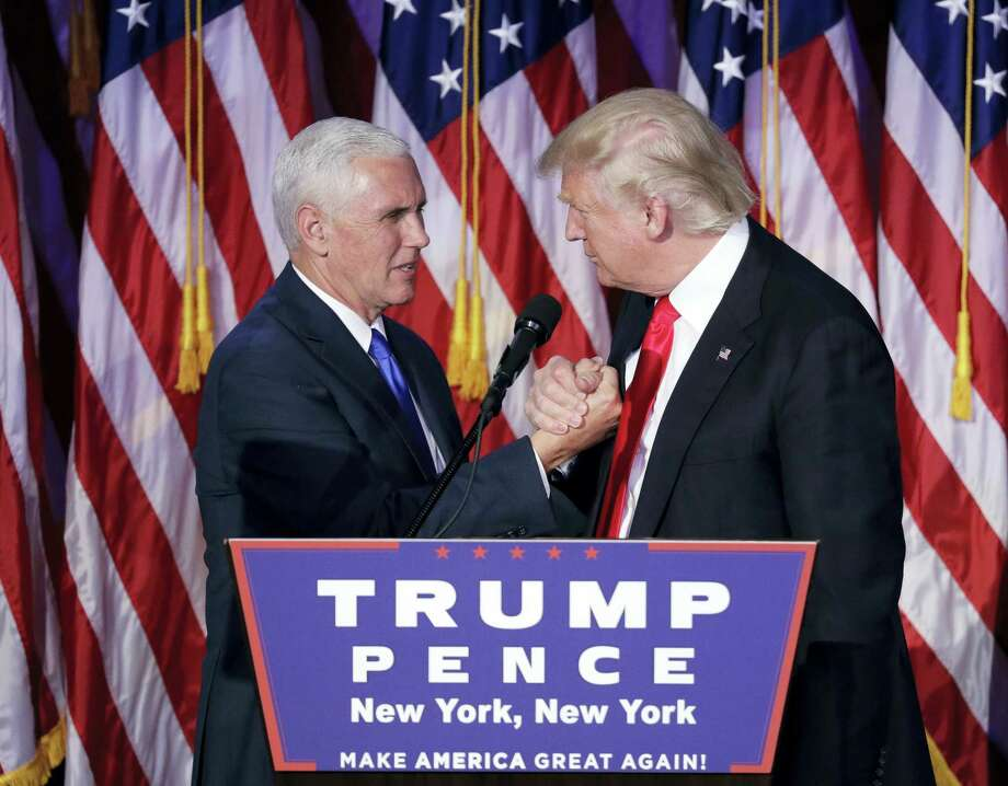 President-elect Donald Trump shakes hands with Vice-President-elect Mike Pence as he gives his acceptance speech during his election night rally early Wednesday in New York. Photo: John Locher — THE ASSOCIATED PRESS   / Copyright 2016 The Associated Press. All rights reserved.