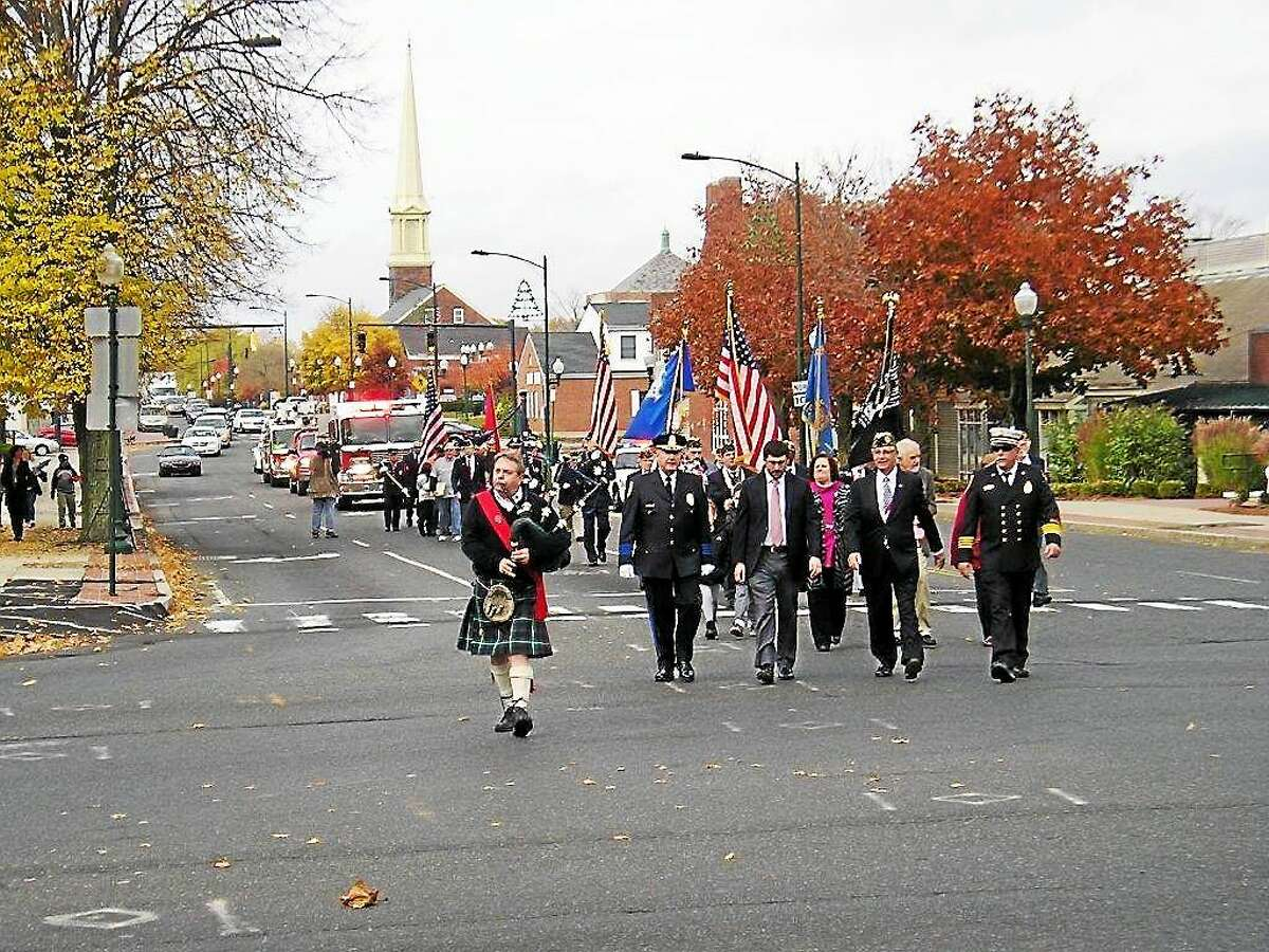 Marching in a previous East Haven Veterans Day parade are from left, Police Chief Brent Larrabee; state Rep. James Albis, D-99, who represents East Haven; Mayor Joseph A. Maturo Jr.; and Assistant Fire Chief Charles Licata.