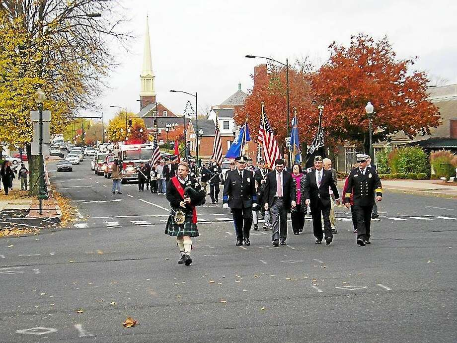 Marching in a previous East Haven Veterans Day parade are from left, Police Chief Brent Larrabee; state Rep. James Albis, D-99, who represents East Haven; Mayor Joseph A. Maturo Jr.; and Assistant Fire Chief Charles Licata. Photo: Contributed PHOTO