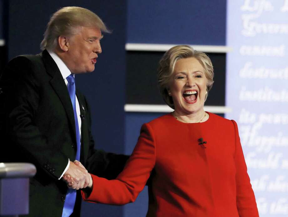 Democratic presidential nominee Hillary Clinton laughs with Republican presidential nominee Donald Trump following their presidential debate at Hofstra University in Hempstead, N.Y., Sept. 26. Photo: Julio Cortez — THE ASSOCIATED PRESS   / Copyright 2016 The Associated Press. All rights reserved.