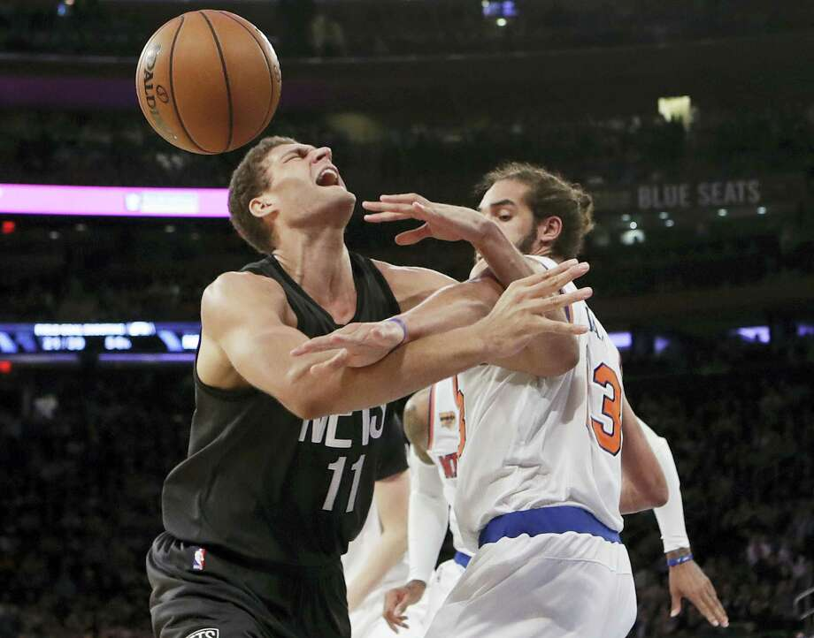 Brooklyn Nets' Brook Lopez (11) and New York Knicks' Joakim Noah compete for control of the ball during the first half of Wednesday's victory for the Knicks. Photo: Frank Franklin II — The Associated Press   / Copyright 2016 The Associated Press. All rights reserved.