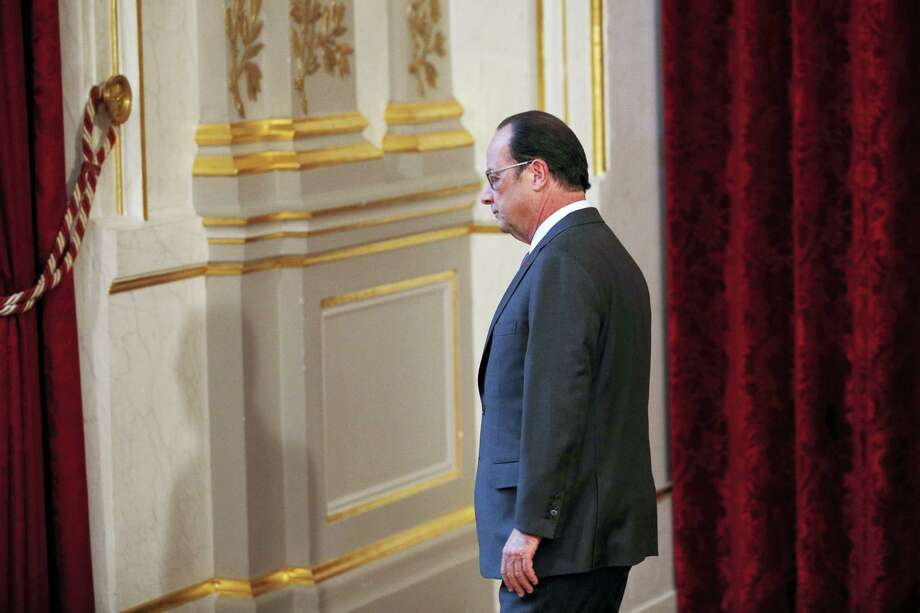 French President Francois Hollande leaves after making a statement after the results of the presidential election in the USA on Wednesday, Nov. 9, 2016 in Paris. European Union leaders have invited U.S. President-elect Donald Trump to come visit the 28-nation bloc as possible to assess trans-Atlantic ties. Photo: Yoan Valat, Pool Via AP   / CHRISTIAN HARTMANN