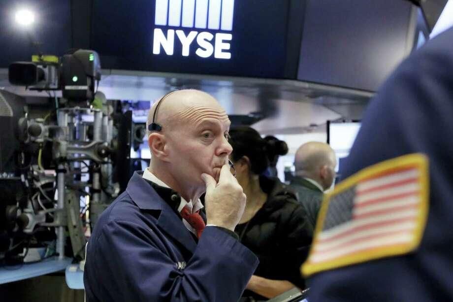 Trader Daniel Porin works on the floor of the New York Stock Exchange Wednesday. Photo: Richard Drew — The Associated Press   / AP