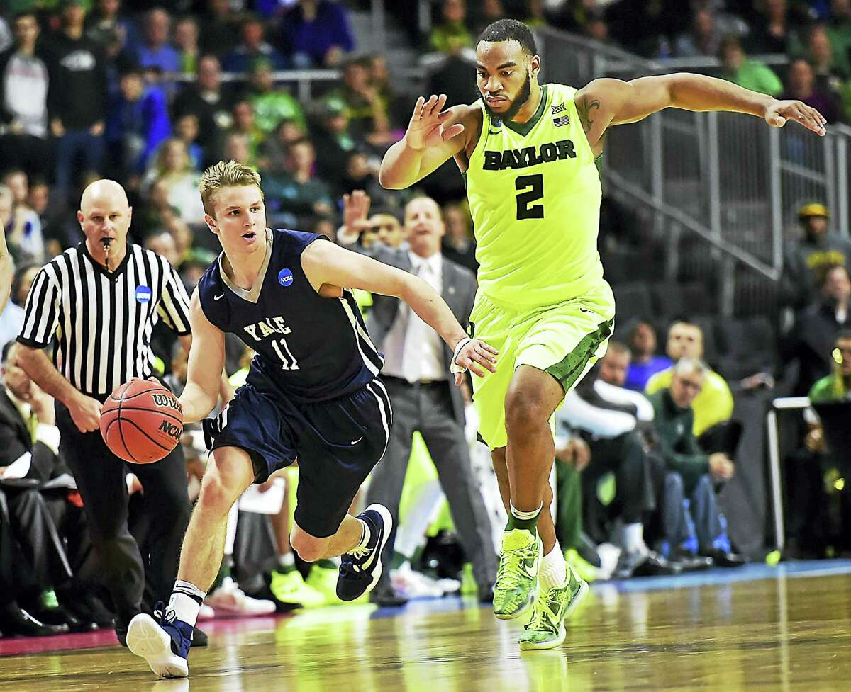 Yale's Makai Mason takes off on a fast break in the final seconds of a 79-75 victory for the Bulldogs over Baylor in the first round of the 2016 NCAA Men's Basketball Tournament last March. Mason will likely miss the entire 2016-17 season with a foot injury suffered during a scrimmage Saturday.