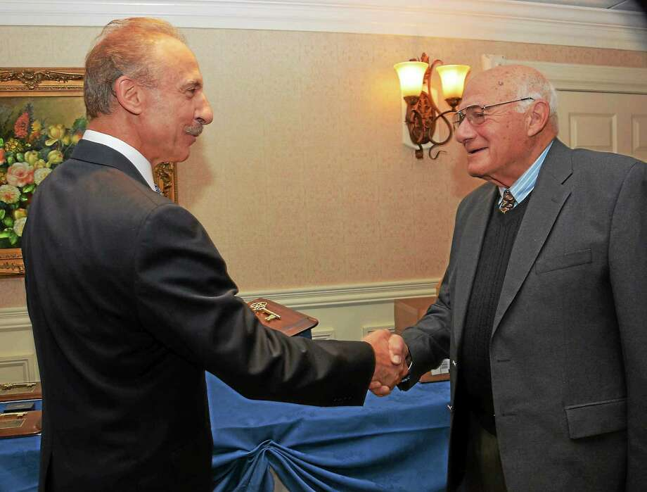 Former Yale football coach Carm Cozza, right, with one of his former players, John Pagliaro, at the 2015 Gold Key dinner. Photo: Special To The Register