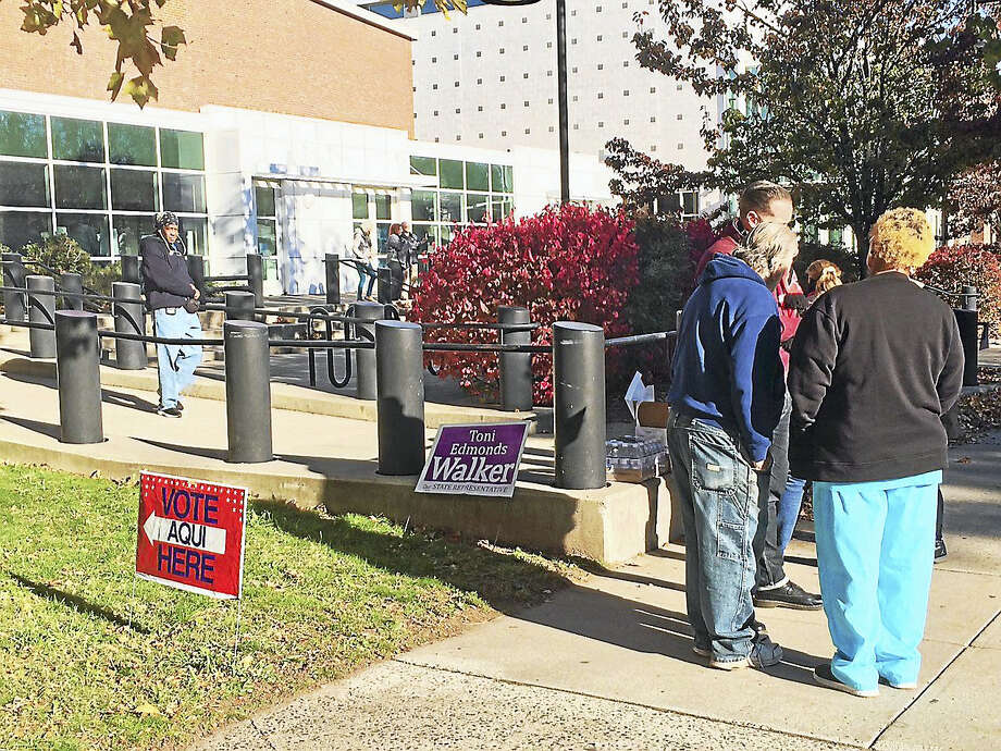 Voters gather outside James Hillhouse High School in New Haven Tuesday. Photo: Wes Duplantier — New Haven Register