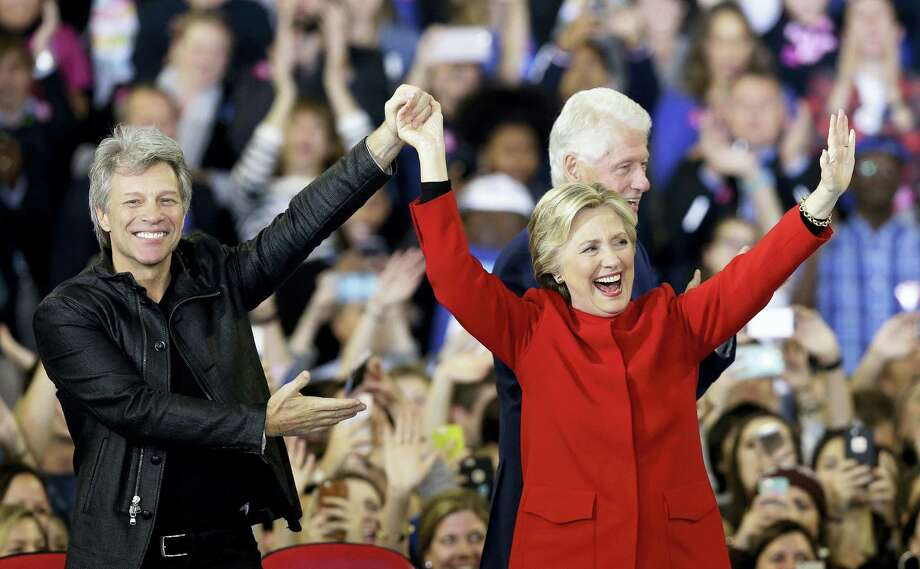 Democratic presidential candidate Hillary Clinton is joined by Jon Bon Jovi, left, and former President Bill Clinton during a campaign rally in Raleigh, N.C. on Tuesday, Nov. 8, 2016. Photo: AP Photo/Gerry Broome   / Copyright 2016 The Associated Press. All rights reserved.