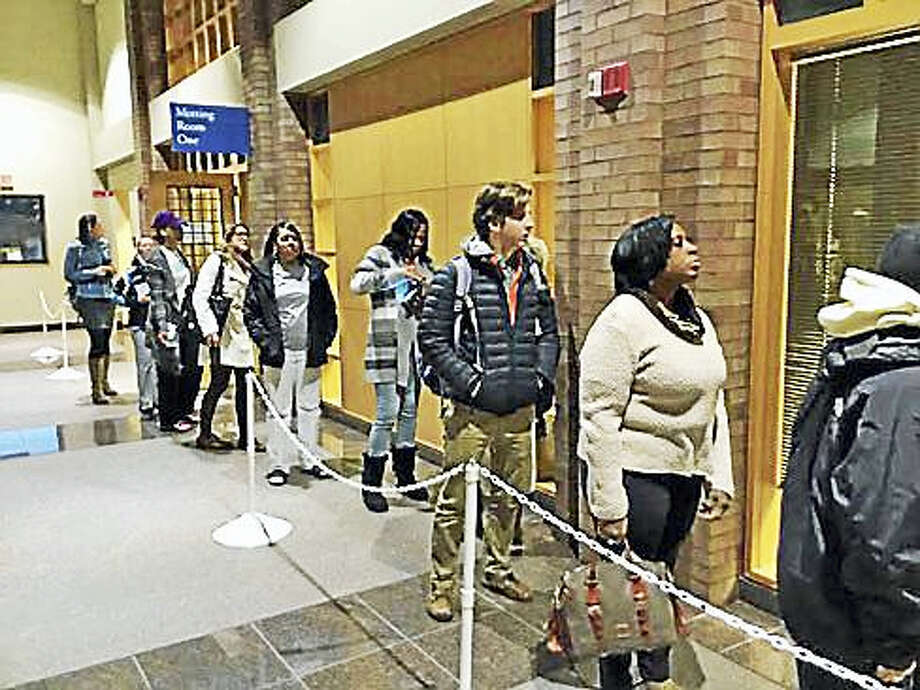 Election Day Registration voters waiting in line after doors opened at 6 a.m. Photo: Jack Kramer Photo