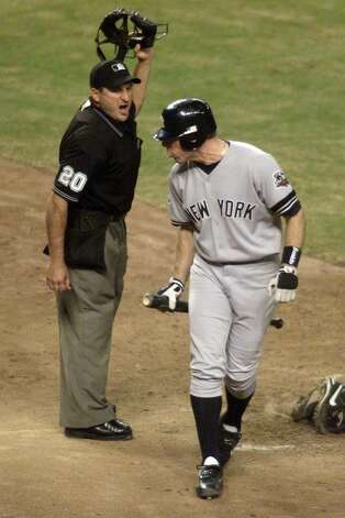 28 Oct 2001: Scott Brosius #18 of the New York Yankees argues being called out on strikes with home plate umpire Mark Hirschbeck in the eigth inning during game two against the Arizona Diamondbacks of the Major League Baseball World Series at Bank One Ballpark in Phoenix, Arizona. The Diamondbacks defeated the Yankees 4-0. DIGITAL IMAGE. Mandatory Credit: Jed Jacobsohn/ALLSPORT Photo: Jed Jacobsohn, Getty Images / Getty Images North America