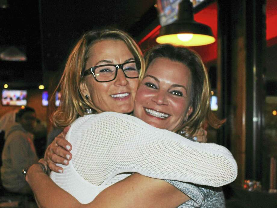 Jean Sonsnovich - For the RegisterThemes Klarides, left, hugs her sister, Nicole Klarides-Ditria Tuesday evening. Klarides won the 114th House District seat for a 10th term. Klarides-Ditria won the 105th House District seat. Photo: Digital First Media