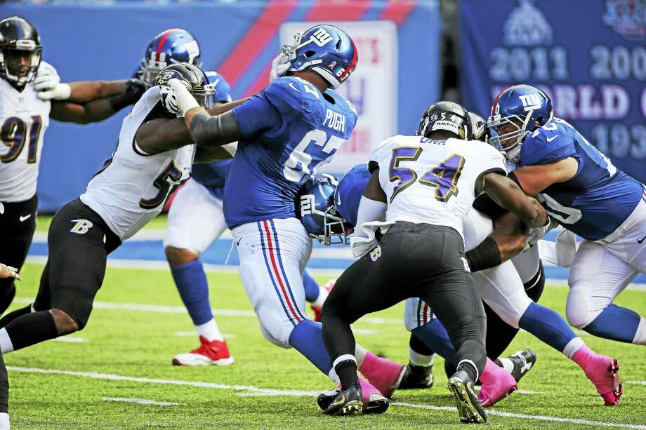 New York Giants offensive guard Justin Pugh (67) blocks during a recent game. Photo: Seth Wenig — The Associated Press   / AP