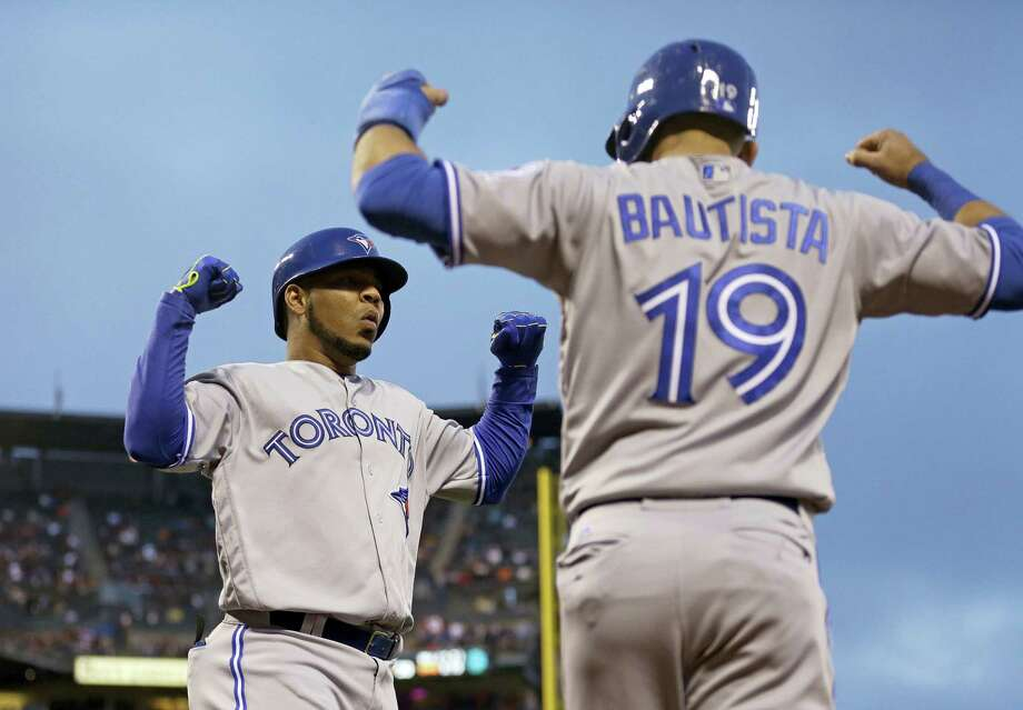 Blue Jays sluggers Edwin Encarnacion, left, and Jose Bautista were among 10 players to receive $17.2 million qualifying offers from their teams on Monday. Photo: Ben Margot — The Associated Press File   / AP