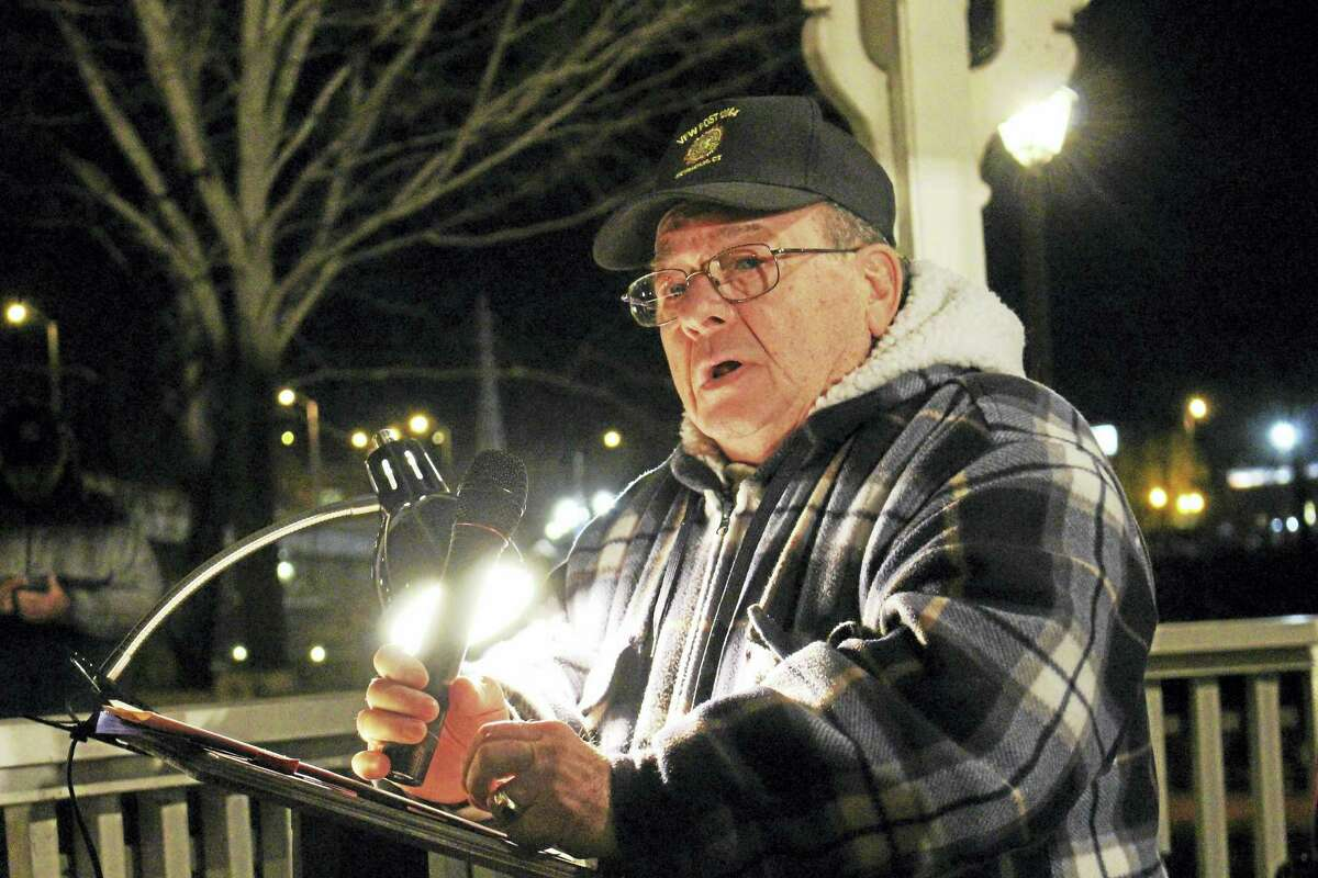 Jean Falbo-Sosnovich - new haven register Al Yagovane, organizer and U.S. Army veteran, plays at the 2015 vigil.