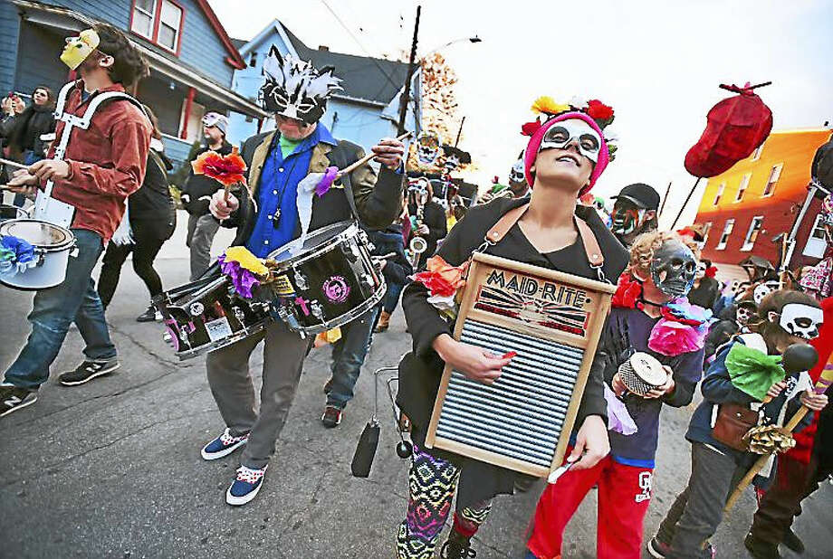 The Hartford Hot Several Brass Band, Lauren Perrault plays the washboard, at center right, and Jeff Jahmke on the drums, center left, march in the Carnaval del Dia de los Muertos — Day of the Dead parade this past weekend in New Haven. Photo: Catherine Avalone — New Haven Register
