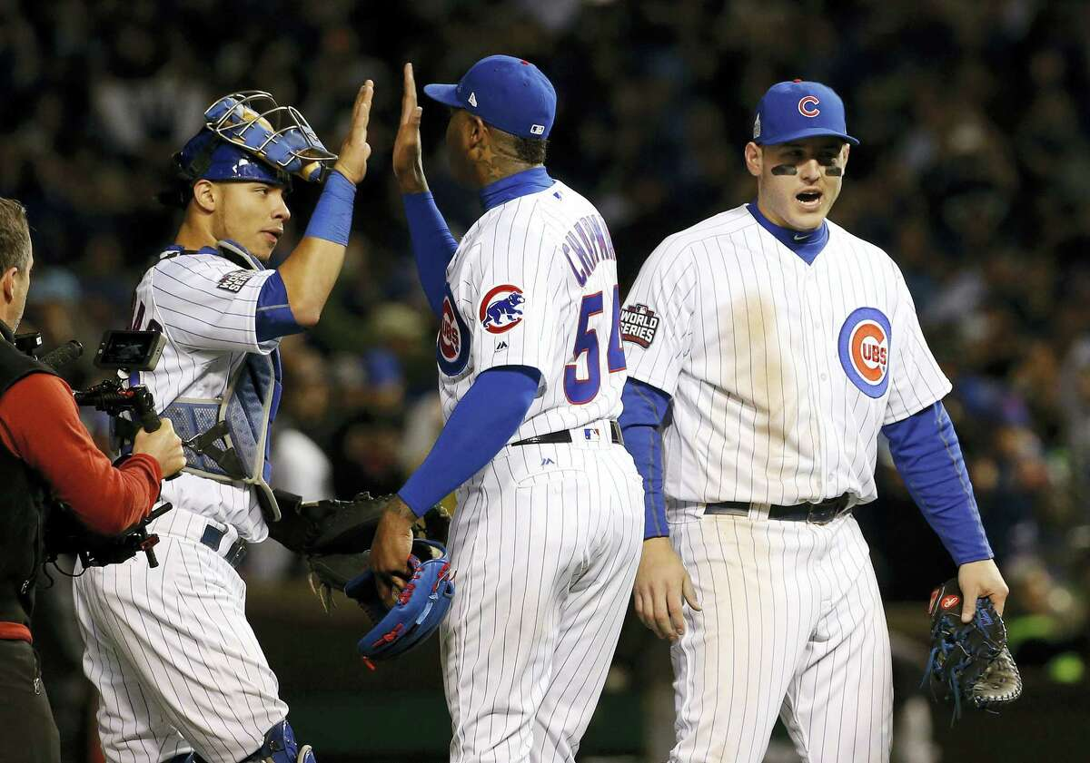 From left, the Cubs' Willson Contreras, left, Aroldis Chapman and Anthony Rizzo celebrate after Game 5 of the World Series on Sunday night in Chicago.