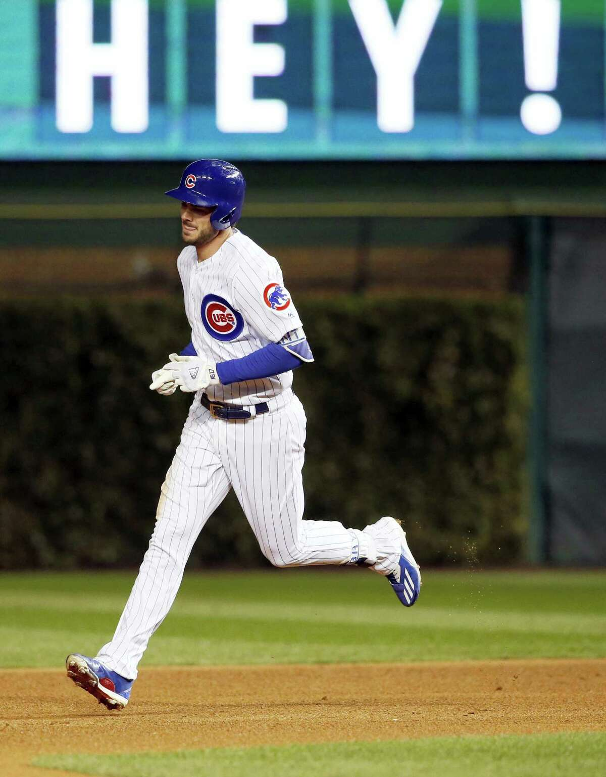 The Cubs' Kris Bryant runs bases after hitting a home run during the fourth inning.