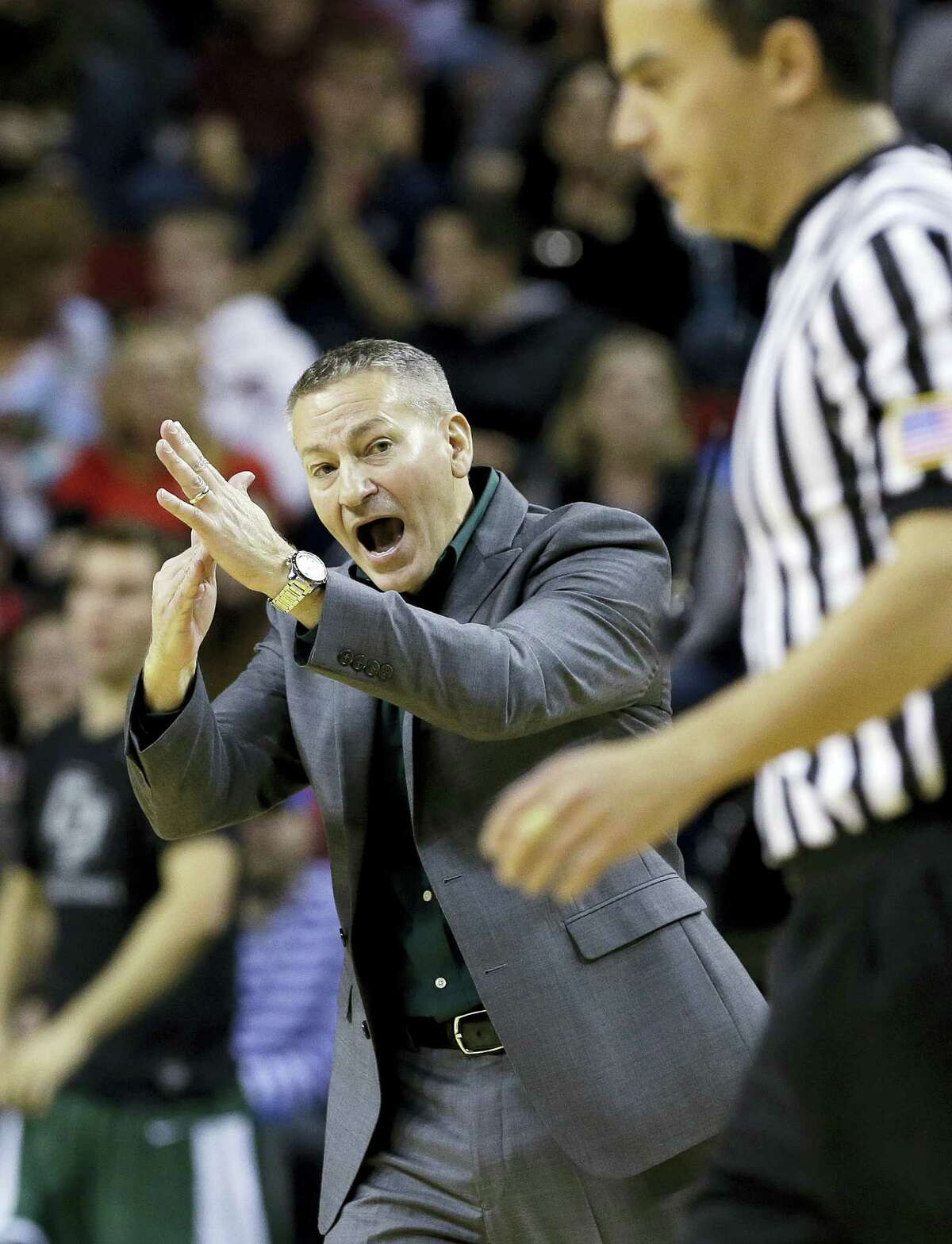 In this Dec. 20, 2014 photo, Cal Poly head coach Joe Callero calls for a time out against Gonzaga in the first half of an NCAA college basketball game, in Seattle. The NCAA has altered a rule put into place last season that took away a coach's ability to call a timeout in live-ball situations. The new variance will allow them to call timeouts now, but only when the team is trying to inbound the ball.