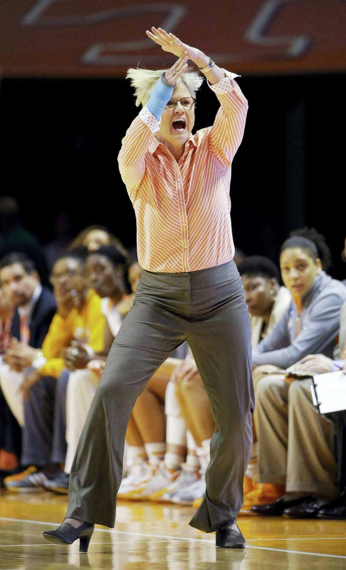 In this March 21, 2015 photo, Tennessee head coach Holly Warlick calls for a timeout in the first half of an NCAA women's college basketball tournament game against Boise State, in Knoxville, Tenn. The NCAA has altered a rule put into place last season that took away a coach's ability to call a timeout in live-ball situations. The new variance will allow them to call timeouts now, but only when the team is trying to inbound the ball.
