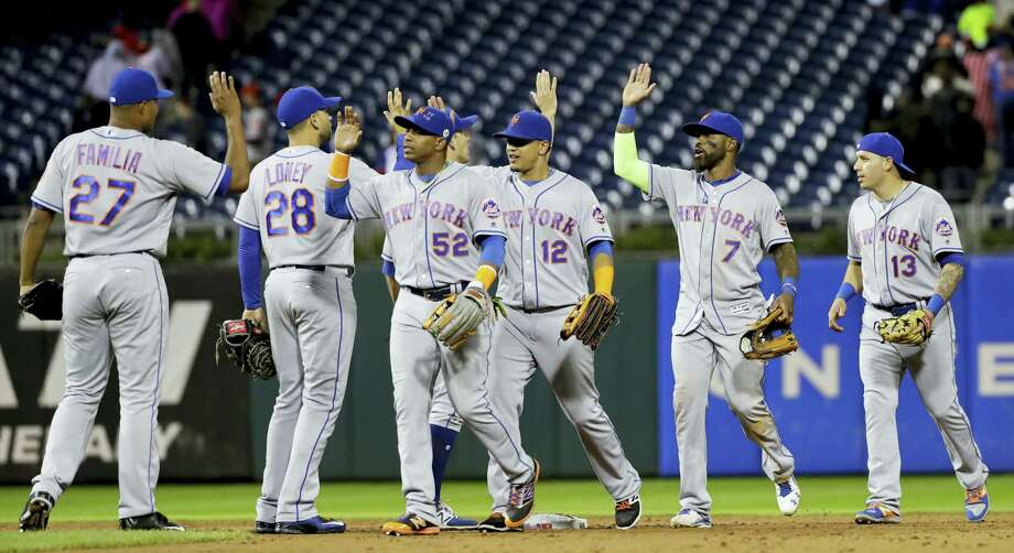 Members of the Mets celebrate after Friday's win over the Phillies on Friday. Photo: Matt Slocum — The Associated Press   / Copyright 2016 The Associated Press. All rights reserved.