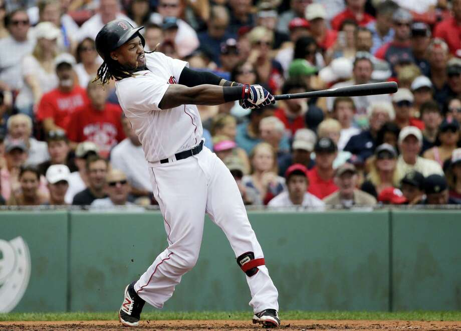 Boston's Hanley Ramirez hits a grand slam in the fifth inning against the Tampa Bay Rays at Fenway Park Wednesday. The Red Sox held on to beat the Rays 8-6. Photo: ELISE AMENDOLA — THE ASSOCIATED PRESS   / AP