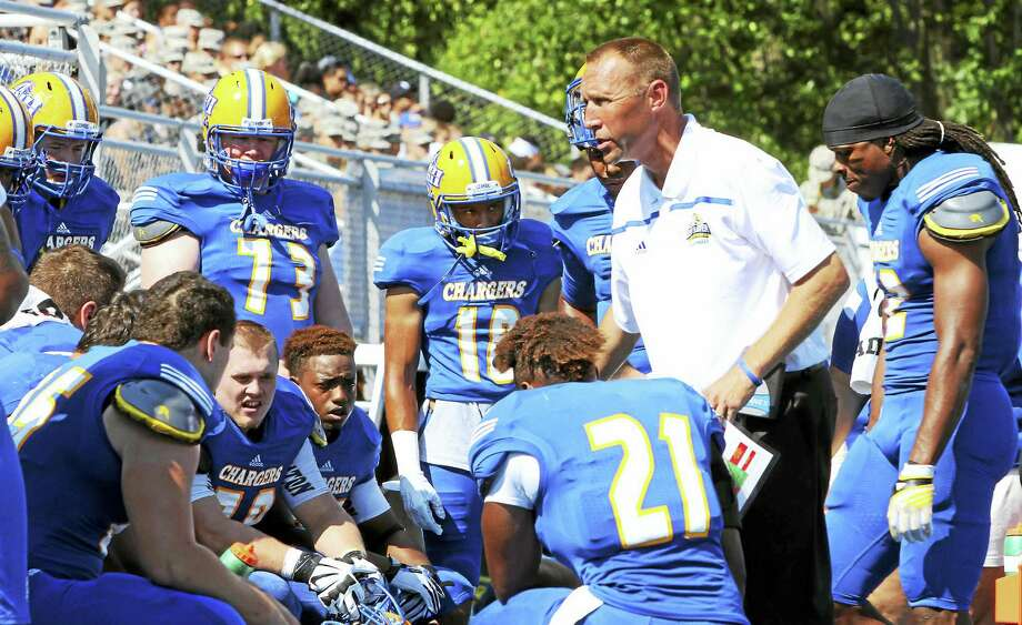 Photo courtesy of the University of New Haven  New Haven football coach Chris Pincince, center, is hoping the Chargers win the Northeast-10 Conference championship this season. Photo: Journal Register Co.
