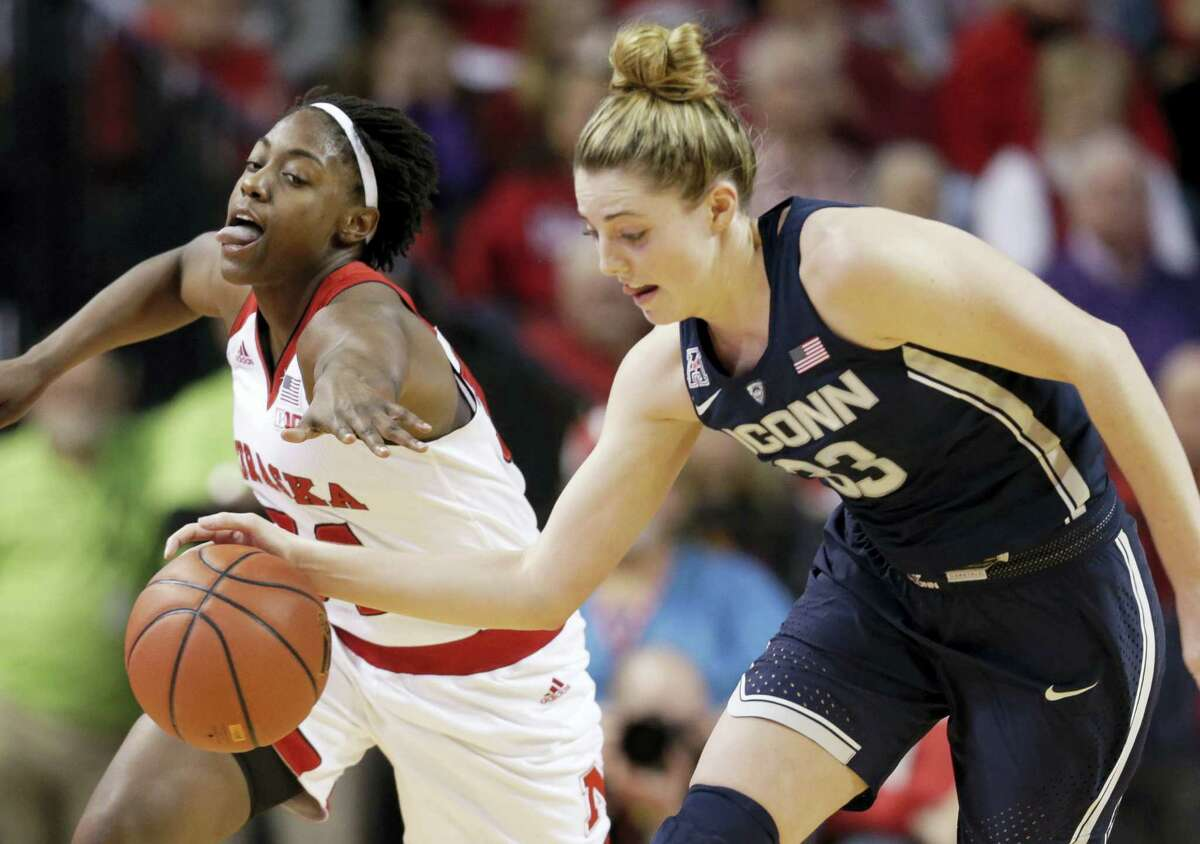 UConn's Katie Lou Samuelson (33) steals the ball away from Nebraska's Jasmine Cincore (34) during the first half of action Wednesday.