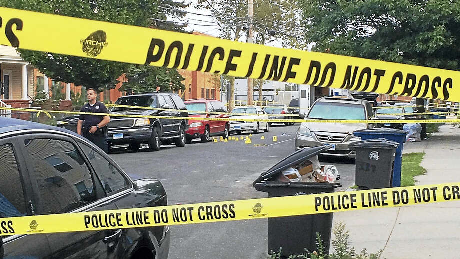 New Haven police investigate Wednesday after a shooting late Tuesday night on Dewitt Street between Spring and Putnam streets left two men dead. Photo: Wes Duplantier — New Haven Register