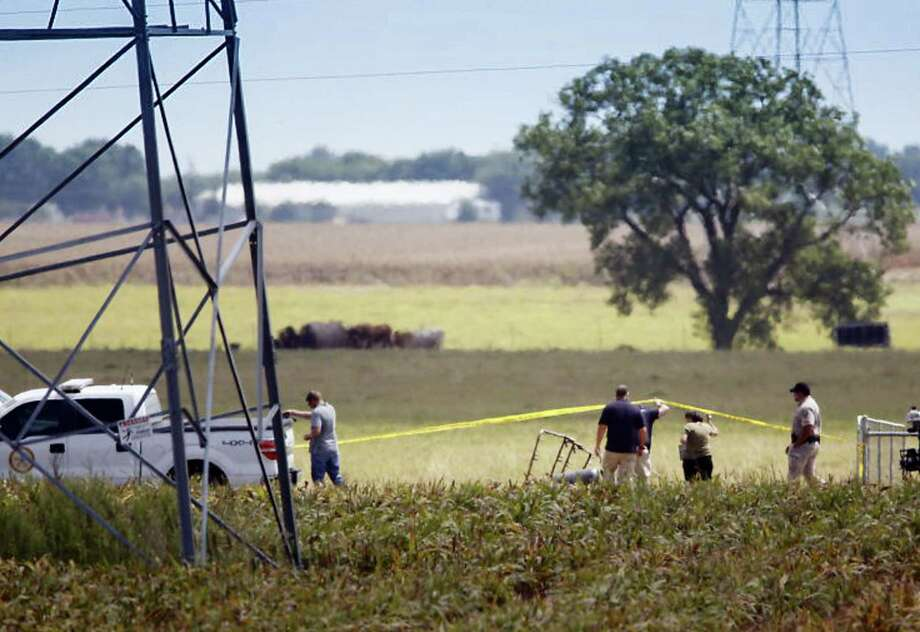 "Investigators surround the scene in a field near Lockhart, Texas where a hot air balloon carrying at least 16 people collided with power lines on July 30, 2016 causing what authorities described as a ""significant loss of life."" Photo: Ralph Barrera/Austin American-Statesman Via AP   / American-Statesman"