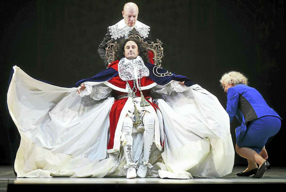 """Cast members Greg Keller as Charles II and George W. Bush, Jeff Biehl as Groom of the Stool, executioner and Karl Rove and Mary Shultz as Barbara Bush in dress rehearsal at the Yale Repertory Theatre world premiere of """"Scenes from Court Life, or the whipping boy and his prince,"""" on Wednesday at University Theatre at 222 York St. in New Haven. The production runs through Oct. 22. Photo: Catherine Avalone — Register   / New Haven RegisterThe Middletown Press"""