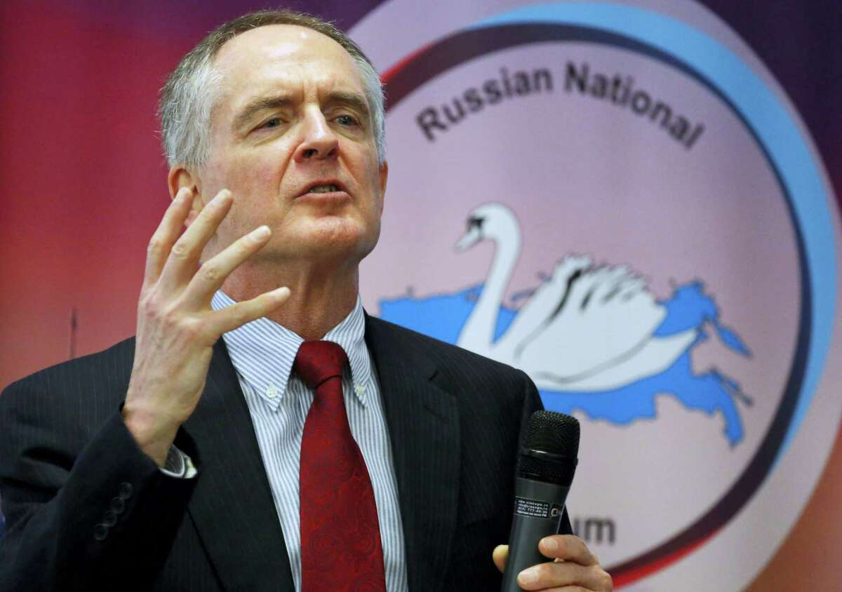 """In a March 22, 2015 photo, U.S. writer Jared Taylor, author of the book """"White Identity"""" speaks during the International Russian Conservative Forum in St. Petersburg, Russia. Taylor, a Yale University-educated, self-described """"race realist,"""" runs the New Century Foundation. The federal government has allowed four groups at the forefront of the white nationalist movement, including the New Century Foundation, to register as charities and raise more than $7.8 million in tax-deductible donations over the past decade, according to an Associated Press review."""