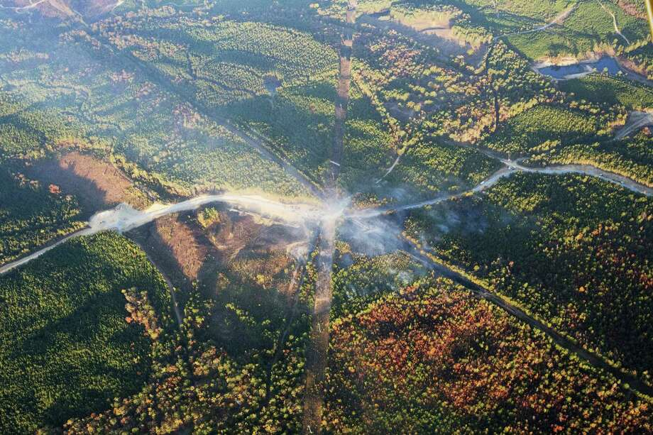 A fog of smoke covers the trees near an explosion of a Colonial Pipeline on Nov. 1, 2016 in Helena, Ala. The pipeline explosion occurred on Monday. The blast, which sent flames and thick black smoke soaring over the forest, happened about a mile west of where the pipeline ruptured in September, Gov. Robert Bentley said in a statement. Photo: AP Photo/Brynn Anderson   / Copyright 2016 The Associated Press. All rights reserved.