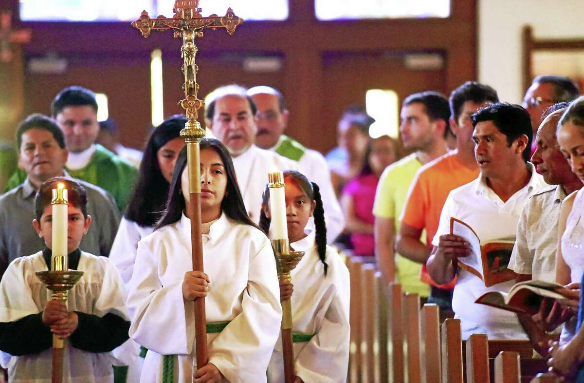 Peter Hvizdak -- New Haven Register A processional starting a Spanish language Mass at the Church of Saint Louis Sunday morning.