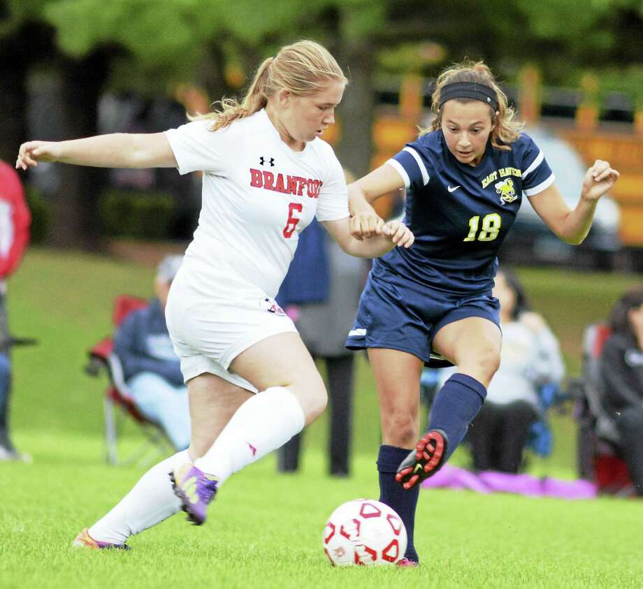 Melanie Sachs of Branford and East Haven's Annmarie DiNicola battle for possession during Branford's 3-0 win Thursday. Photo: Dave Phillips/GameTimeCT