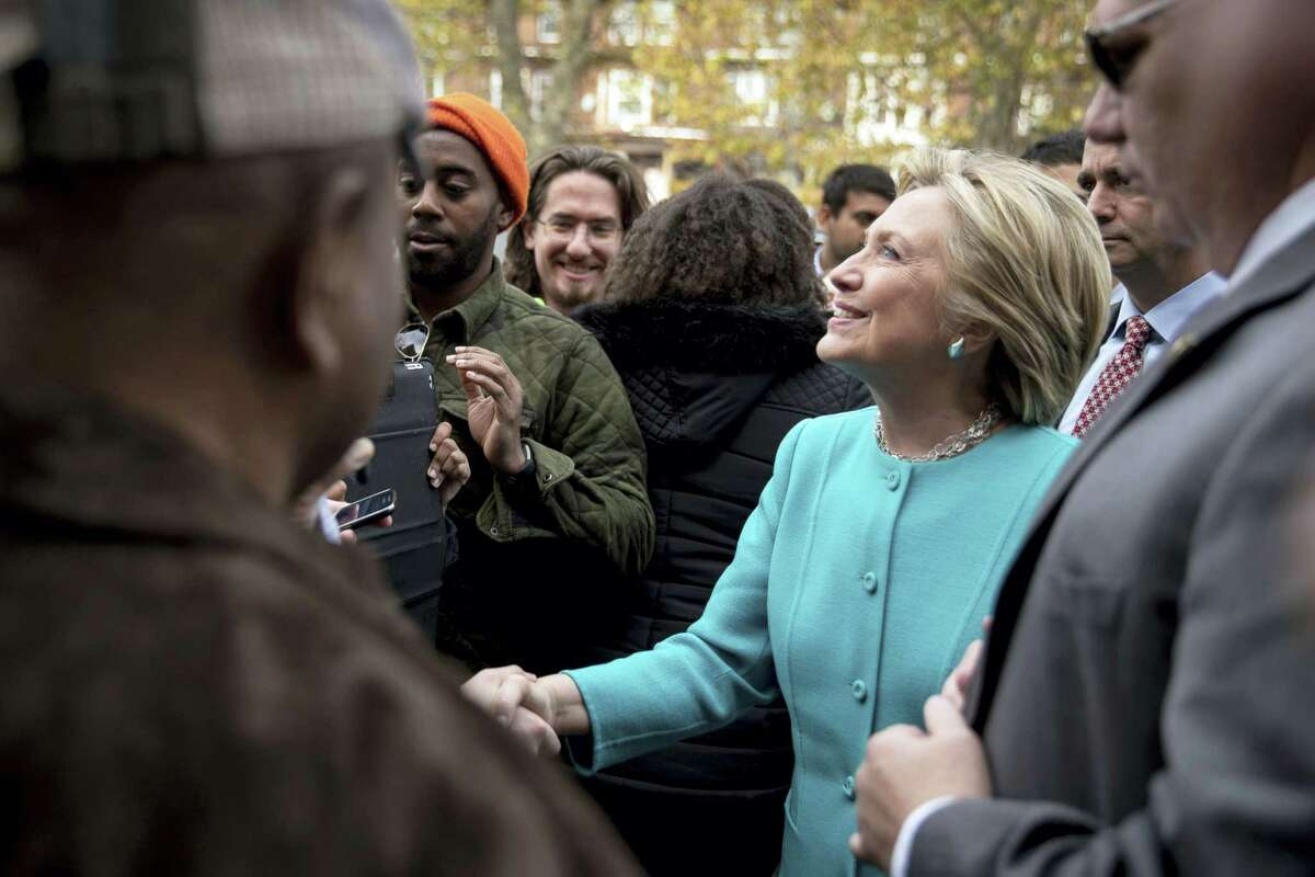 Democratic presidential candidate Hillary Clinton greets people outside Cedar Park Cafe in Philadelphia on Nov. 6, 2016.