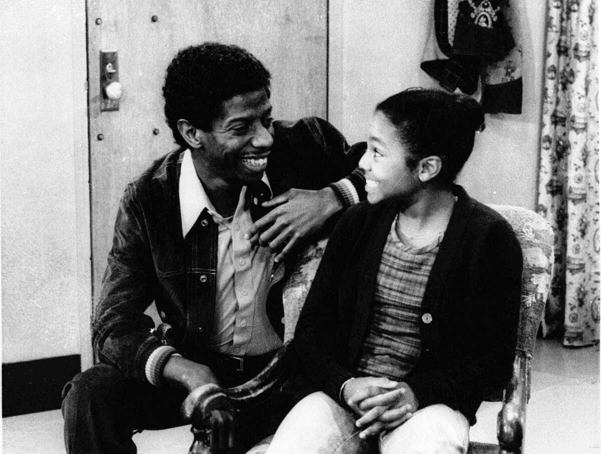 """In this Sept. 28, 1977 photo, Jimmie Walker, left, appears with co-star Janet Jackson in an episode of """"Good Times."""" In the 1970s, Norman Lear was unveiling a slate of hit sitcoms that addressed hot-button issues of the day, particularly racial equality as depicted in """"Sanford and Son,"""" """"Good Times"""" and """"The Jeffersons."""""""