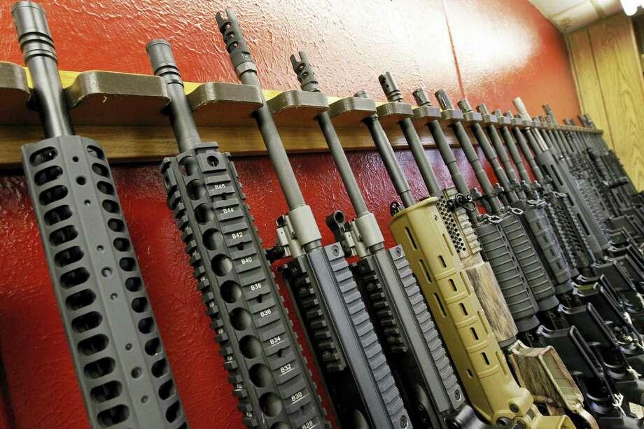 A row of different AR-15 style rifles are displayed for sale at the Firing-Line indoor range and gun shop in Aurora, Colo. Photo: AP Photo/Alex Brandon, File   / AP