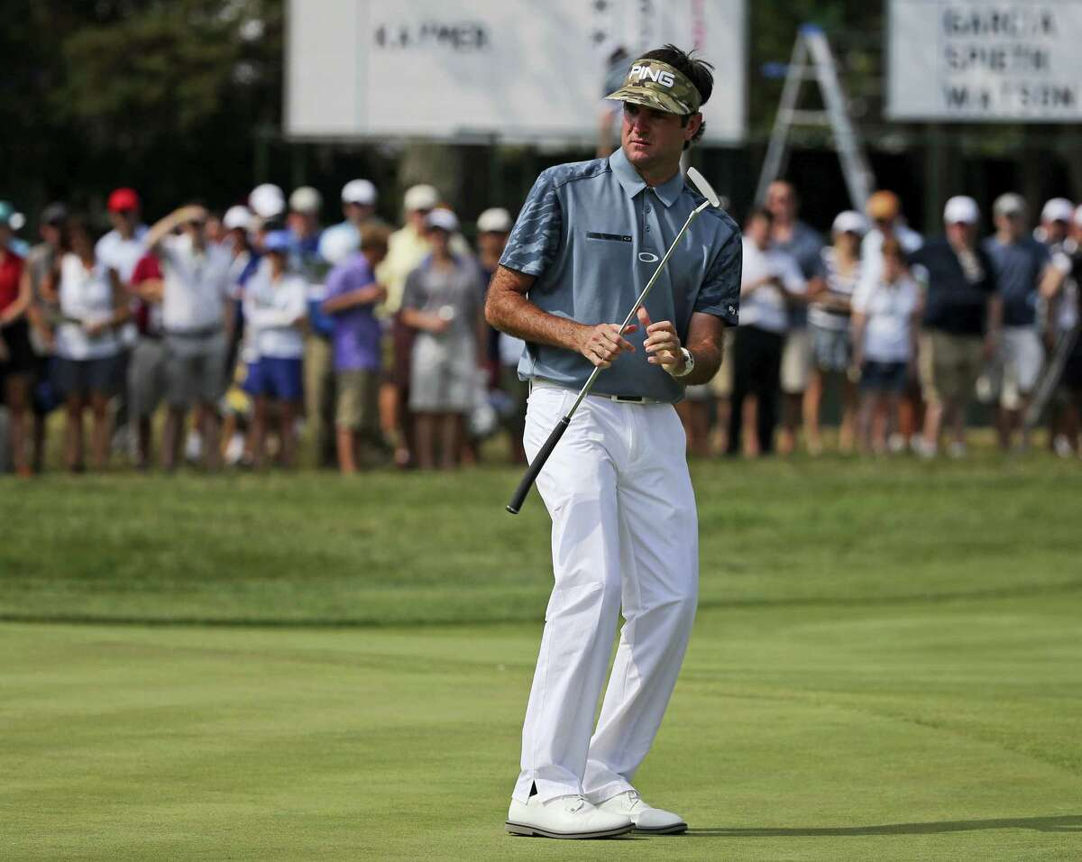 Bubba Watson reacts to missing a putt on the 11th hole during the first round of the PGA Championship golf at Baltusrol Golf Club in Springfield, N.J. Watson is committed to play again at the Travelers, where he is the defending champion.