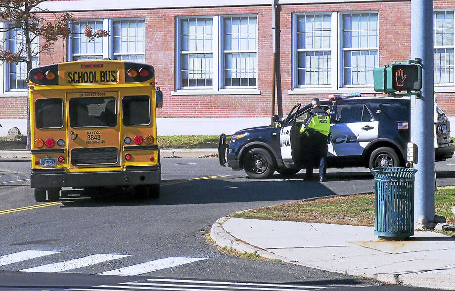 Students at Hamden High School were evacuated then released early Monday after someone called in a threat against the school. Several police units were on scene checking the campus. Photo: Wes Duplantier — The New Haven Register