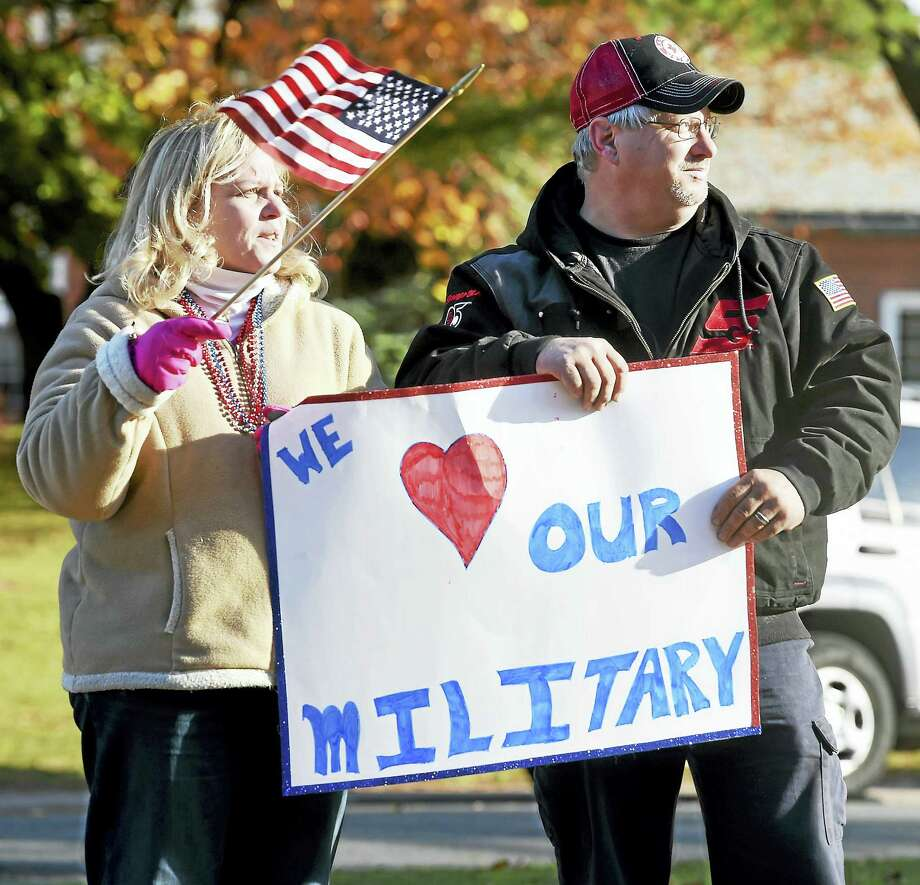 Arnold Gold-New Haven Register  Fran Perri (left) and her husband, Todd Girven, of East Haven watch the Veterans Day Parade in Branford Sunday. Photo: Digital First Media