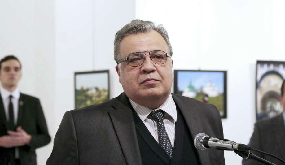 Andrei Karlov, the Russian Ambassador to Turkey, pauses during a speech at a photo exhibition in Ankara on Monday, Dec. 19, 2016, moments before a gunman opened fire on him. Karlov was rushed to a hospital after the attack and later died from his gunshot wounds. Photo: Burhan Ozbilici — AP Photo   / AP