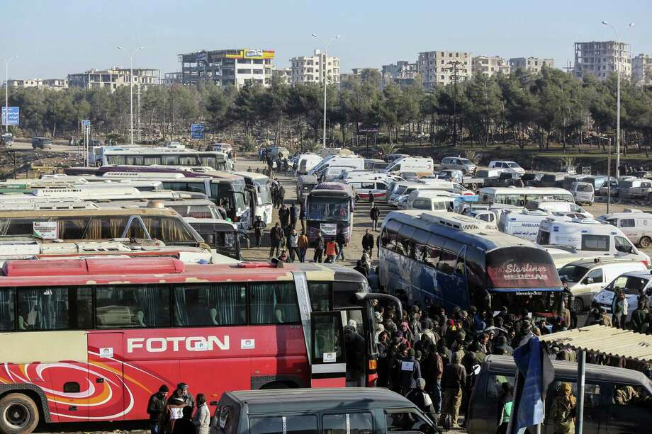 Syrians evacuated from the embattled Syrian city of Aleppo during the ceasefire arrive at a refugee camp in Rashidin, near Idlib, Syria, Tuesday, Dec. 20, 2016. Russian Foreign Minister Sergey Lavrov said on Tuesday that Russia, Iran and Turkey are ready to act as guarantors in a peace deal between the Syrian government and the opposition. He spoke on Tuesday after a meeting of the three countries' foreign ministers in Moscow. Photo: AP Photo / Copyright 2016 The Associated Press. All rights reserved.