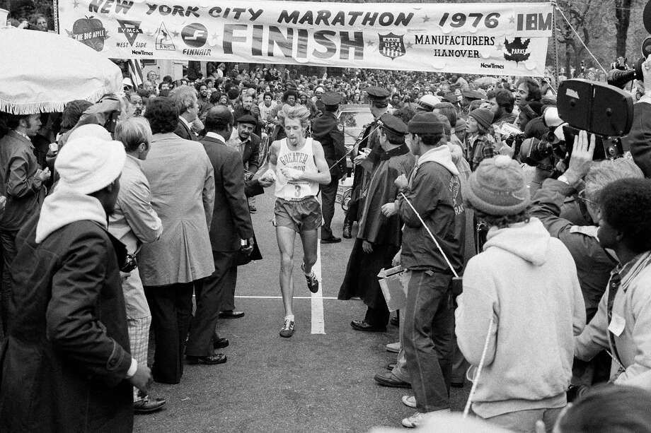 Bill Rodgers crosses the finish line to win the 1976 New York City Marathon. Forty years ago, Rodgers, one the world's top two marathon runners was handed $3,000 as a secret reward for spicing up the very first five-borough New York City Marathon. Photo: The Associated Press File Photo   / AP1976